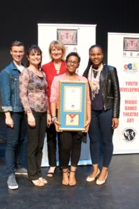 Principal Liz van Tonder joins our Arts department on stage with our NEA Prestige Award